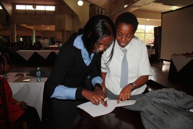 training-the-trainer-edwinah-combar-of-woolworths-village-market-teaching-a-student-at-kenya-high-school-how-to-go-about-reading-the-bra-measuring-chart